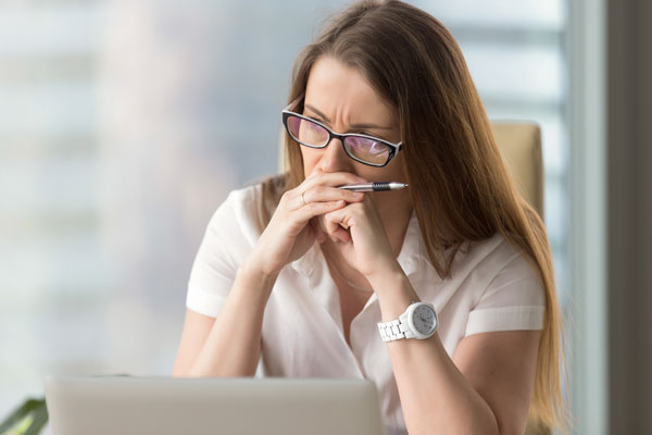 woman thinking of applying for a life insurance reduction
