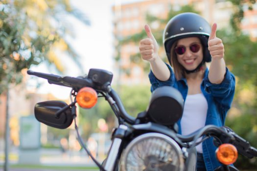 Satisfied young woman after hiring the best scooter insurance