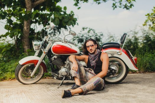 Young man thinks about the best insurance for a large displacement motorcycle